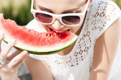 Girl in white summer dress eat watermelon Stock Photo