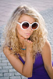 Girl in white sun glasses Stock Images