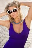 Girl in white sun glasses Stock Images