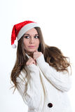 The girl in a white sweater and a Christmas cap Royalty Free Stock Photo