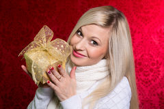 A girl in a white sweater with a gift bow with bandaged looking Stock Photos