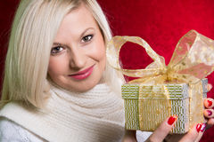 A girl in a white sweater with a gift bow with bandaged looking Stock Image
