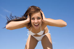 Girl in white swimwear crying against the sky Royalty Free Stock Image