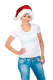 Girl in a white T-shirt and hat of Santa Stock Photography