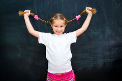 Girl in a white T-shirt lifted pigtails Stock Photos