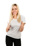 Girl in a white t-shirt shows thumbs Stock Images