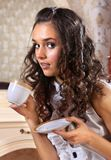 Girl with white tea cup Stock Photography