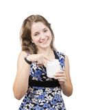 Girl with white toiletries container Royalty Free Stock Images