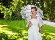 Girl with white umbrella on the grass under a tree Stock Photography