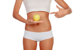 Girl in white underwear with a apple Royalty Free Stock Image