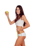 Girl in white underwear with a apple and tape measure Stock Photos