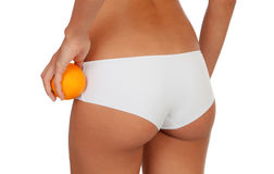 Girl in white underwear with a orange Stock Photo
