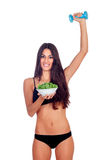 Girl in white underwear with a salad and exercising with dumbbel Stock Photography