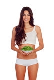 Girl in white underwear with a salad Royalty Free Stock Photo
