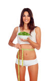 Girl in white underwear with a salad and tape-measure Stock Photography