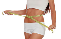 Girl in white underwear with a tape measure around her waist Stock Photo