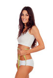 Girl in white underwear with a tape measure around her waist Stock Image