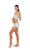 Girl in white underwear with tape measure saying Ok Stock Photography