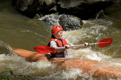 Girl white water kayaking Stock Photo