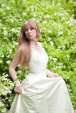 The girl in a white wedding dress Stock Images