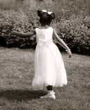 Girl in white wedding dress dancing. On a wedding party (sepia Stock Photo