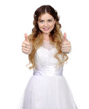 Girl in white wedding dress, make thumbs up Royalty Free Stock Photography