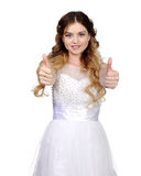 Girl in white wedding dress, make thumbs up Royalty Free Stock Image