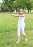 Girl in white wet clothes Stock Photography