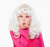 Girl in White Wig and Diadem Posing as Princess Stock Photo