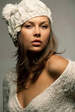 Girl in white wool and cap. Young attractive girl in white wool and cap Stock Image