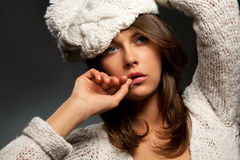 Girl in white wool and cap Royalty Free Stock Photography