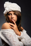 Girl in white wool and cap Stock Image