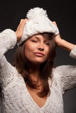 Girl in white wool and cap Royalty Free Stock Images