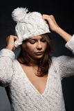 Girl in white wool and cap Royalty Free Stock Image