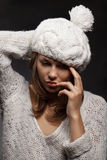 Girl in white wool and cap Royalty Free Stock Photos