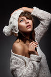 Girl in white wool and cap Stock Photos