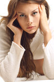 Girl in white wool sweater Stock Image
