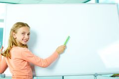 Girl by the whiteboard Stock Images