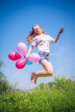 Girl whith balloons in park Royalty Free Stock Images