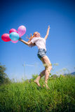 Girl whith balloons in park Royalty Free Stock Image
