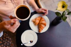 A girl whith coffe and croissants royalty free stock images