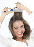 Girl who brush their hair Royalty Free Stock Image