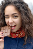 Girl who did not get a piece of the chocolate bar Royalty Free Stock Images