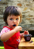 Girl who eats Stock Image