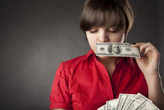 Girl who has a lot of money Royalty Free Stock Image