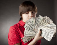 Girl who has a lot of money Stock Images