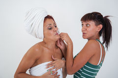 Girl who helps a friend to shave Royalty Free Stock Image