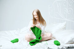 Girl who knits on the needles Stock Image
