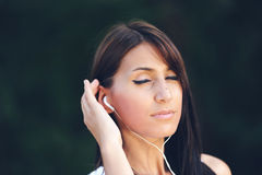 Girl who listens to music Stock Photo
