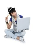 A girl who is looking for ideas by using a laptop. And a pencil, on white background Stock Image